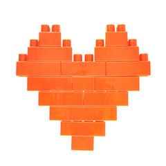 Heart symbol made of toy bricks