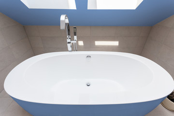Blue bathtub in bathroom
