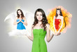 canvas print picture - Beautiful young brunette woman choosing between angel and devil