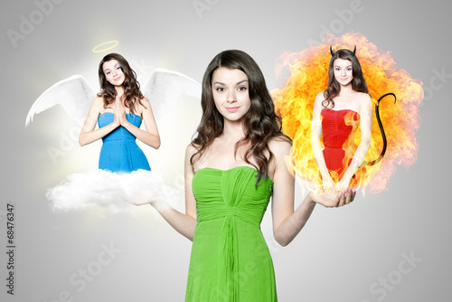 canvas print picture Beautiful young brunette woman choosing between angel and devil