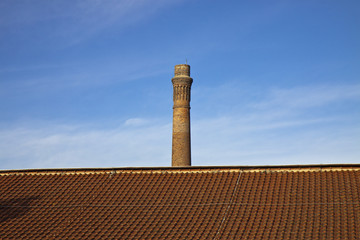 Old brick chimney isolated on sky