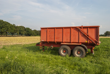 Red trailer on field