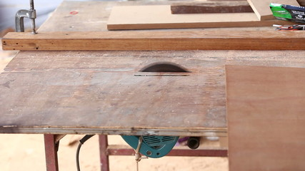 carpenter use saw cut wood for make new furniture