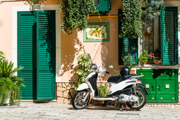 Retro scooter and traditional style Italy house
