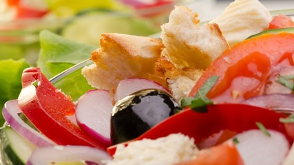 Fresh salad with feta cheese, red onion, cucumber, radish, black