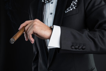 Man's hand with a cigar