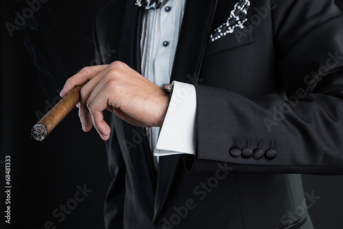 Man's hand with a cigar - 68481333