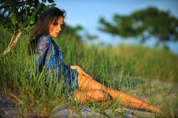 Beautiful brunette girl enjoying summer on the beach.