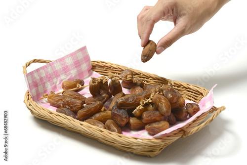 Hand Holding Dates Fruit