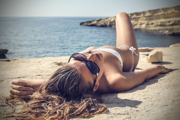 blonde girl sunbathing