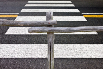 Wooden fence and pedestrian crossing - concept image