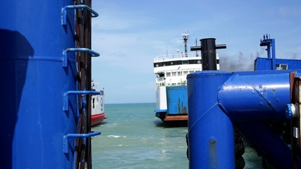 Ferry Leaves Dock in Thailand.