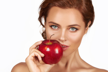 Young sexy woman holding big red apple smile, teeth