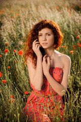 Portrait of beautiful red hair girl at sunset