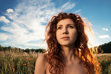Close-up portrait of beautiful woman on the sunset