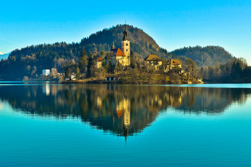 St. Martin Church on Island in Lake Bled with Mountains