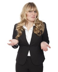 Young businesswoman shrugging her shoulders