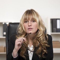 Attentive attractive young businesswoman