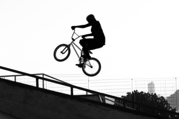 BMX - Girl jumping with bike