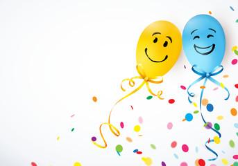 zwei smiley-ballons mit konfetti
