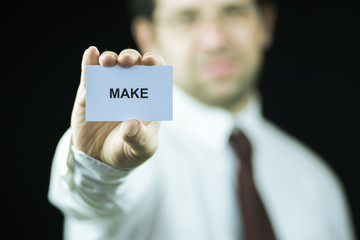 Businessman holding a card