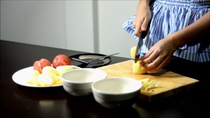 time lapse woman peeling an apple