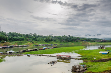Rural life view of wooden Mon Bridge in Sangkhla Buri