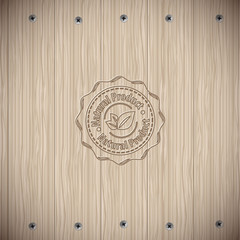 Wooden texture background with screws and badge