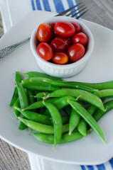 green sugar beans and cherry tomatoes