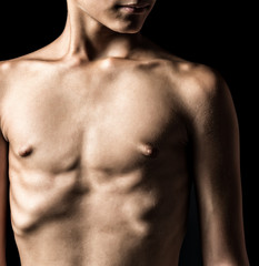 Nude torso of a young man