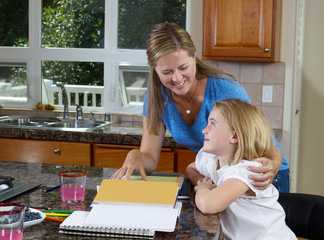 Mother and daughter working on homework