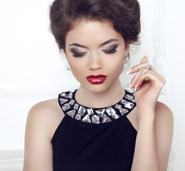 Makeup. Jewelry. Beauty. Brunette woman with red sexy lips, eye
