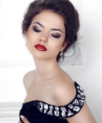 Makeup. Beauty portrait of brunette sexy girl model posing in fa