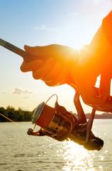 .Fishing at sunset
