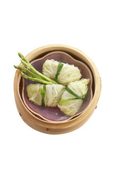 vegetarian chinese food in bamboo basket on white background