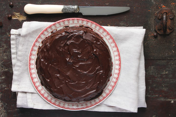 Chocolate cake with marmalade, nuts and chocolate frosting