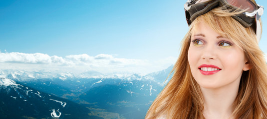 smiling teenage girl in snowboard goggles