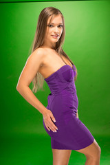 Young Woman in Sexy Violet Dress Side View Pose