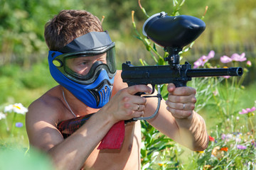 Extreme paintball game in the garden