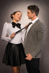 Happy Lovely Couple in Trendy Attire Isolated Gray