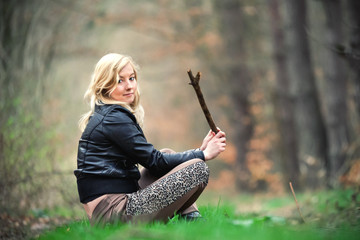 Blond girl in the forest