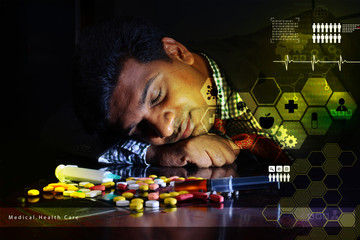 doctor rest with his head on heap of pills