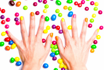 Women's hands in bright candies