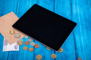 Trendy gadget and money from the mail envelope