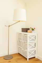 Commode and lamp in bright room