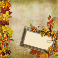 Wooden frame with autumn leaves on a vintage background