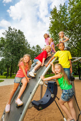 Children on playground construction play together