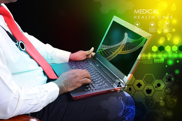 Doctor with stethoscope and laptop