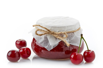 jar of fruit jam with cherries