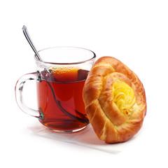 Bun with custard and tea
